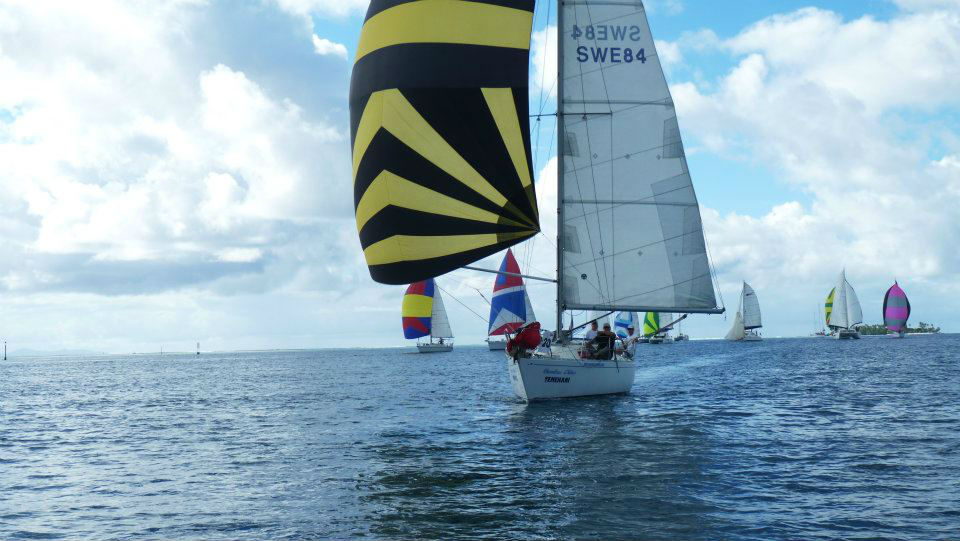Windfall with spinnaker in Tahiti Pearl Regatta