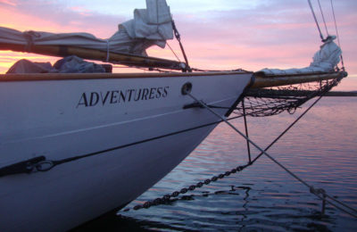 Bow at sunset sailing yacht Adventuress