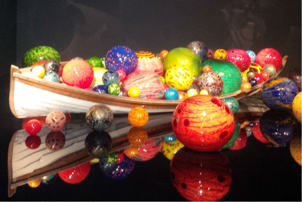 Dale Chihuly canoe with color glass gloes