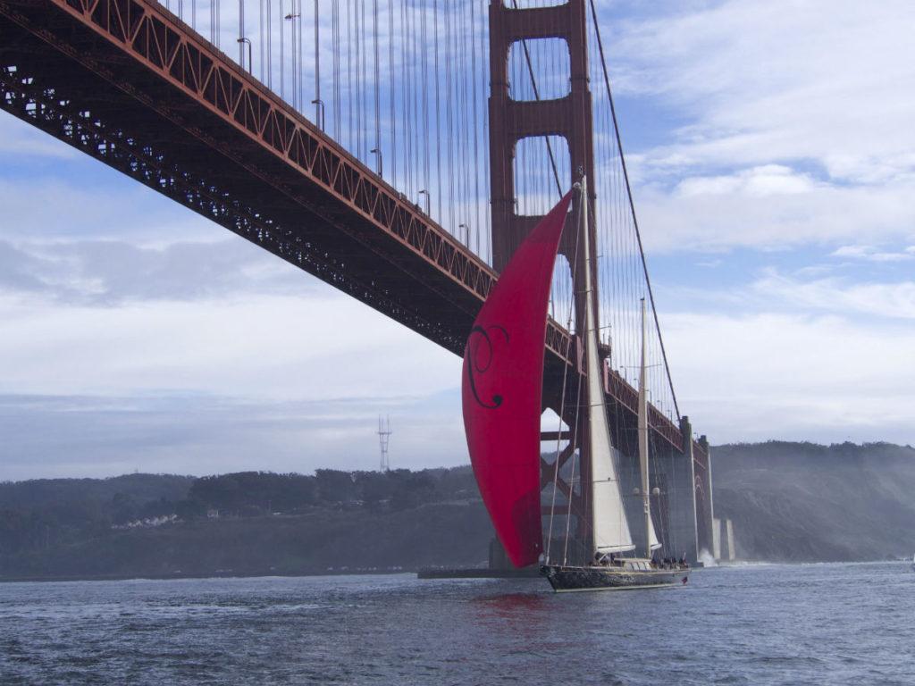 Saling Yacht THalia sils under Golden Gate Bridge San Francisco
