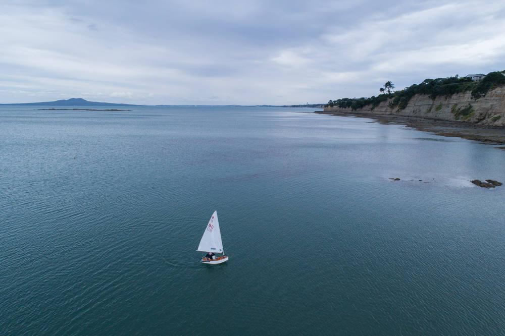Sailing P Class dingy along the New Zealand coast
