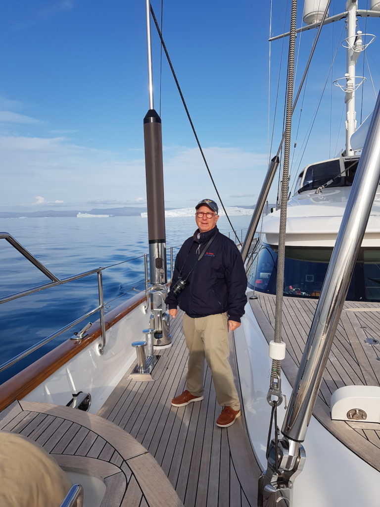 Ron Holland on deck of sailing yacht Rosehearty while cruising the Northwest Passage summer 2019