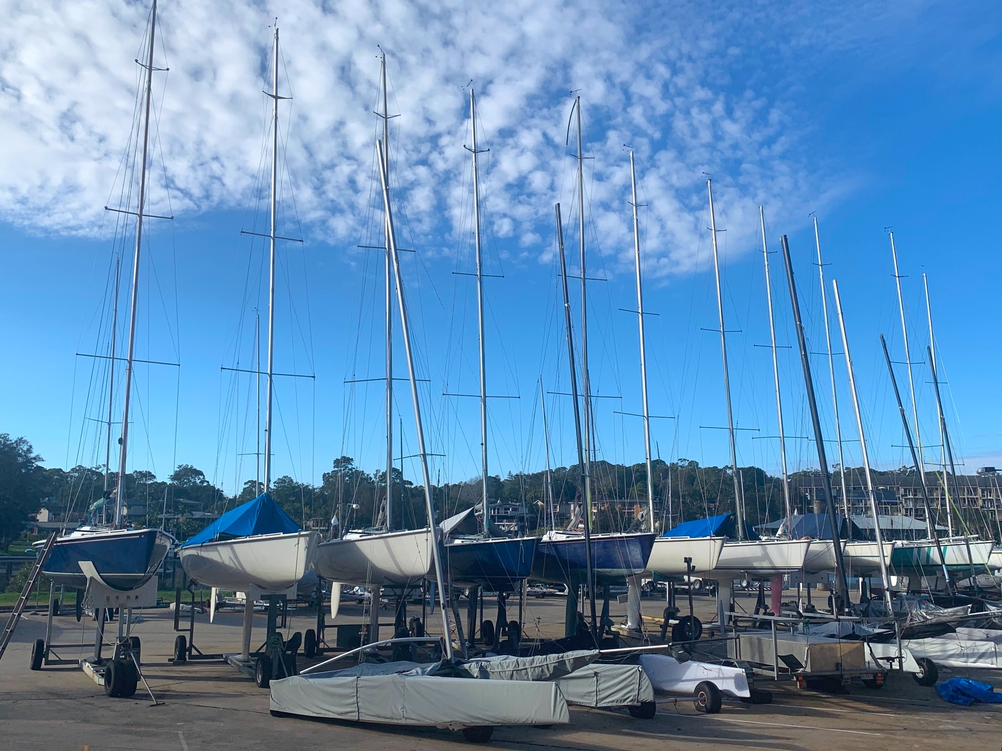 Eleven 11Metre sailing yachts wait a dock Royal Prince Alfred Yacht Club Newport Australia