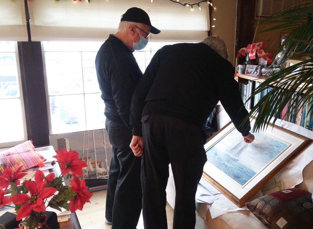 Ron Holland meets with marine artist John Horton to discuss details of painting commission of superyacht Wavelength Too
